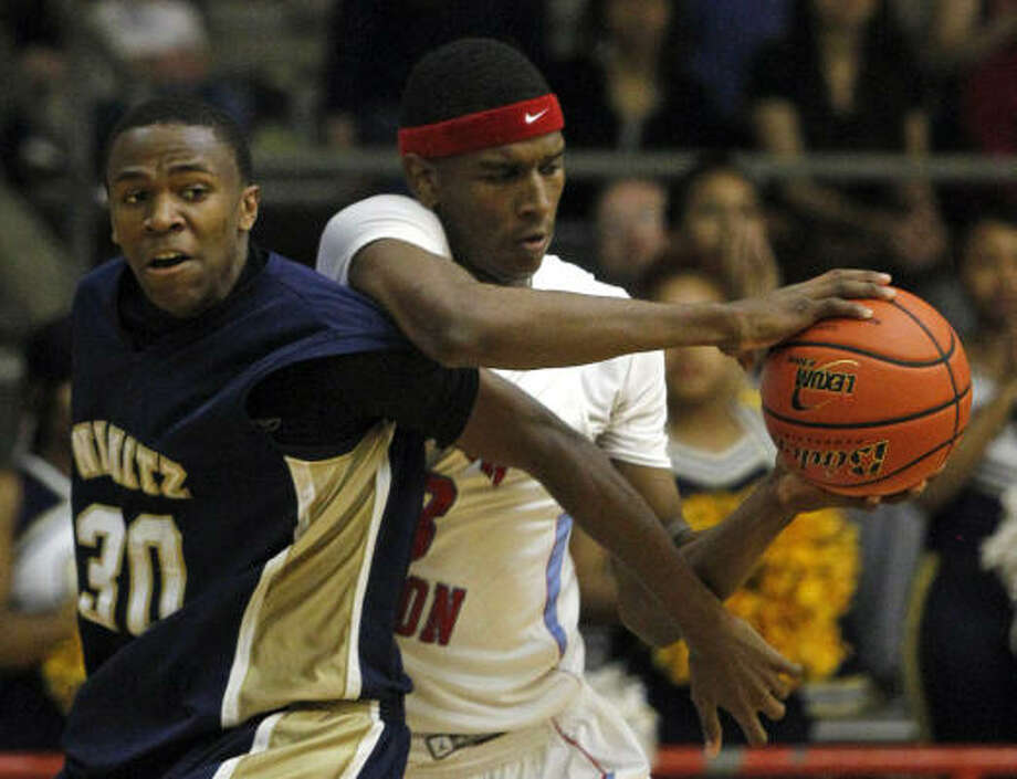 Feb. 24: Madison 71, Nimitz 67 Madison's Roderick Smith, right, works to keep the ball from Nimitz's Sam Segura during the second quarter of Thursday's playoff game at Butler Fieldhouse. Photo: Melissa Phillip, Chronicle
