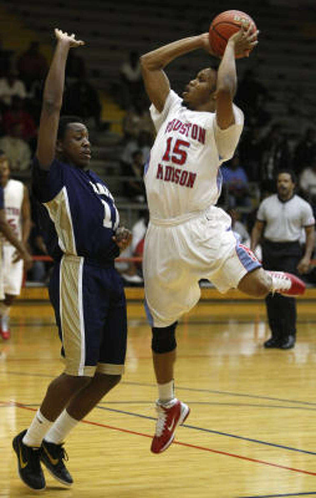Madison's Daniel Wilson shoots over Nimitz's Stephen Williams during the first quarter.