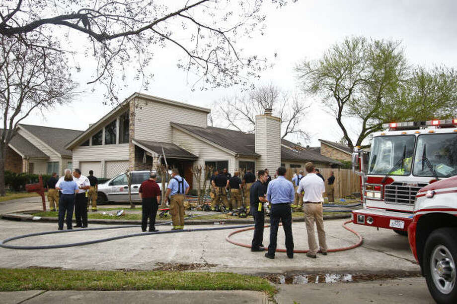 The fire struck at a home housing Jackie's Child Care, at 2810 Crest Park Lane. Photo: Michael Paulsen, Chronicle
