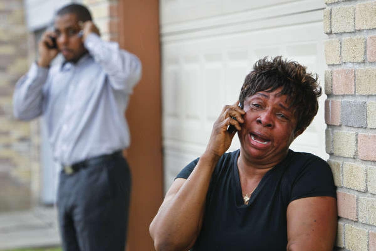A devastated Missy Tata, Jessica Tata's mother, talks on the phone.