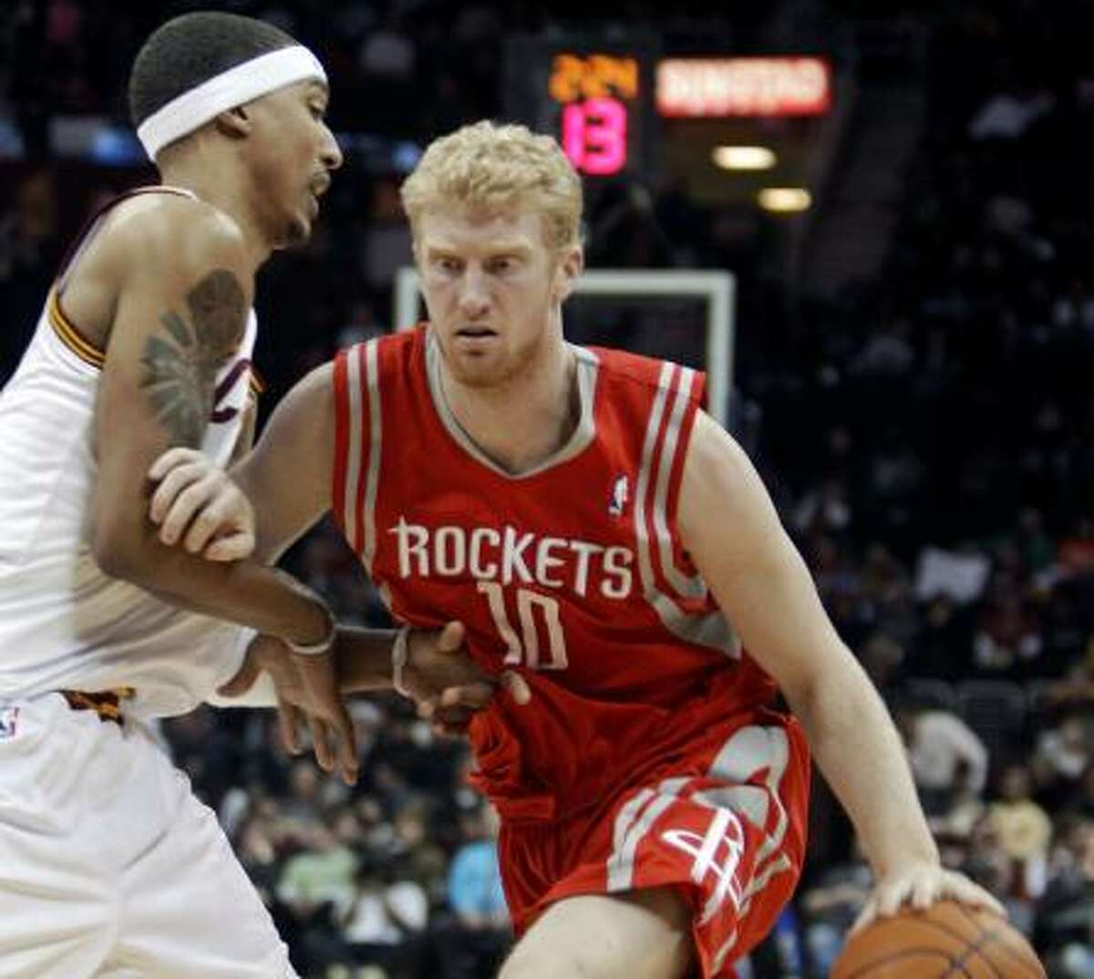 Feb. 23: Rockets 124, Cavaliers 119 Rockets forward Chase Budinger (10) drives past Cleveland's Jamario Moon in the third quarter. Budinger scored a career-high 30 points off the bench, including 11 straight in the fourth quarter, to lead the Rockets past the Cavaliers on Wednesday night in Cleveland.