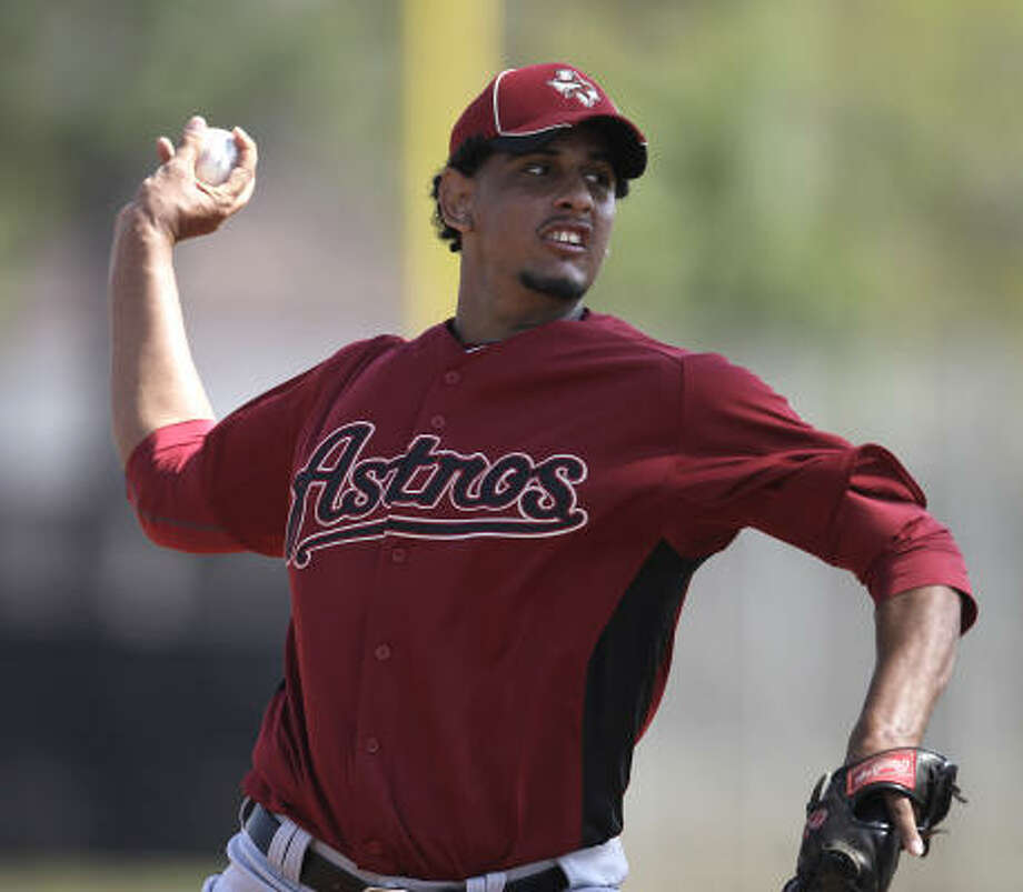 Pitcher Aneury Rodriguez throws live batting practice. Photo: Karen Warren, Chronicle