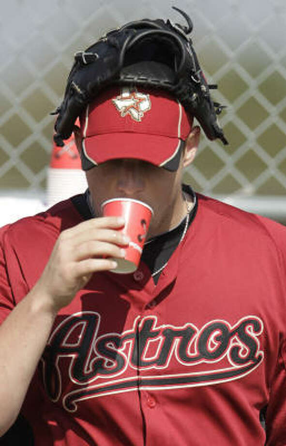 Astros pitcher Bud Norris takes a break from drills for a bit of water. Photo: Karen Warren, Chronicle