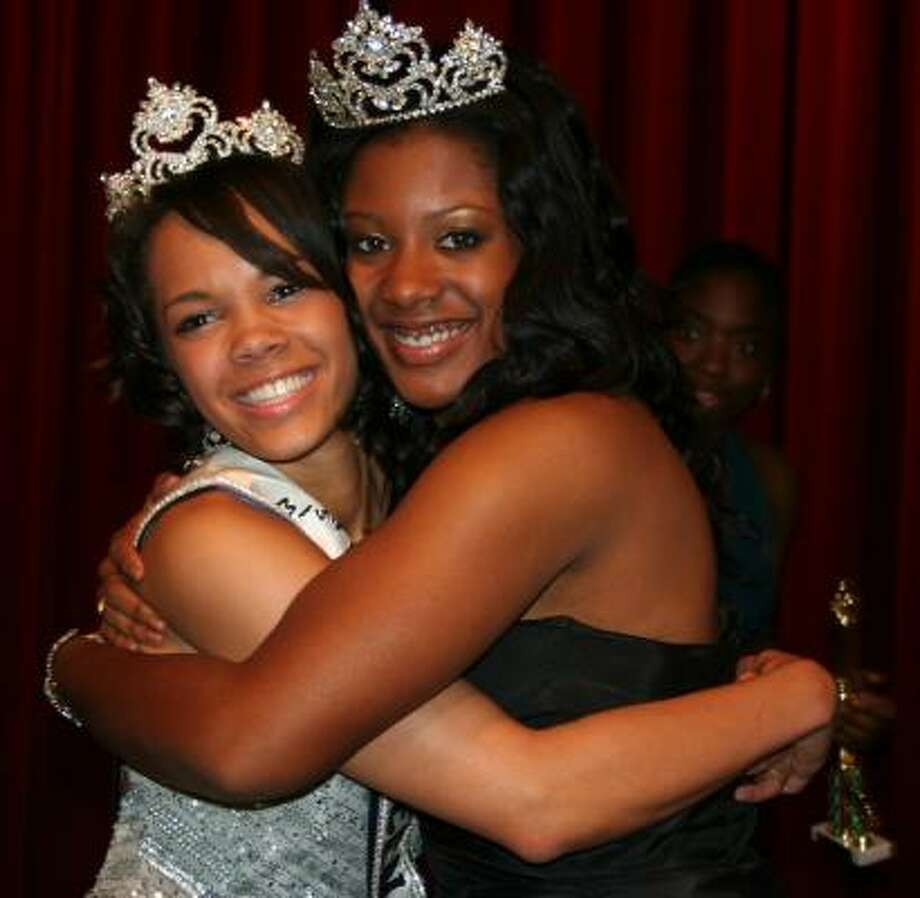 Stafford resident Nicole Hickl, left, is hugged after winning the title of Miss Black Teen Texas USA 2009 by Jordan Franklin, Miss Black Teen Texas USA 2008.