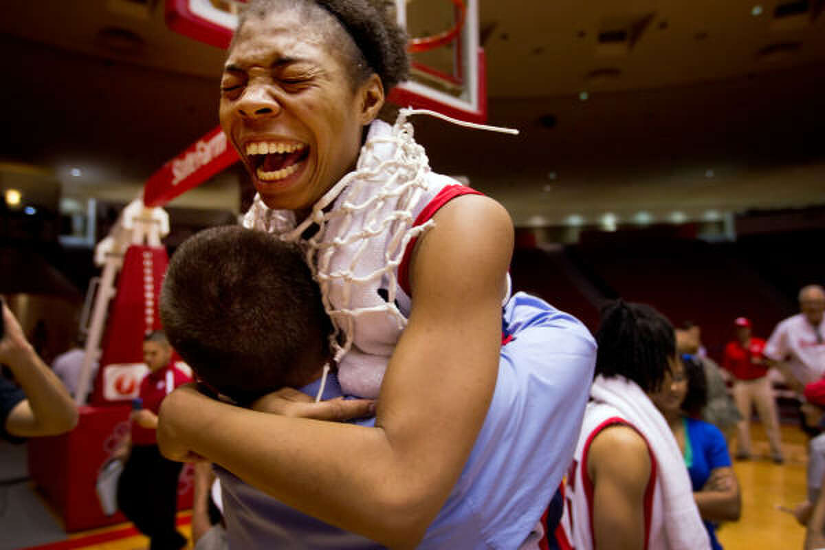 Cougars forward Courtney Taylor (24) celebrates with head coach Todd Buchanan following the Cougars victory over UTEP in NCAA women's basketball action at Hofheinz Pavilion.