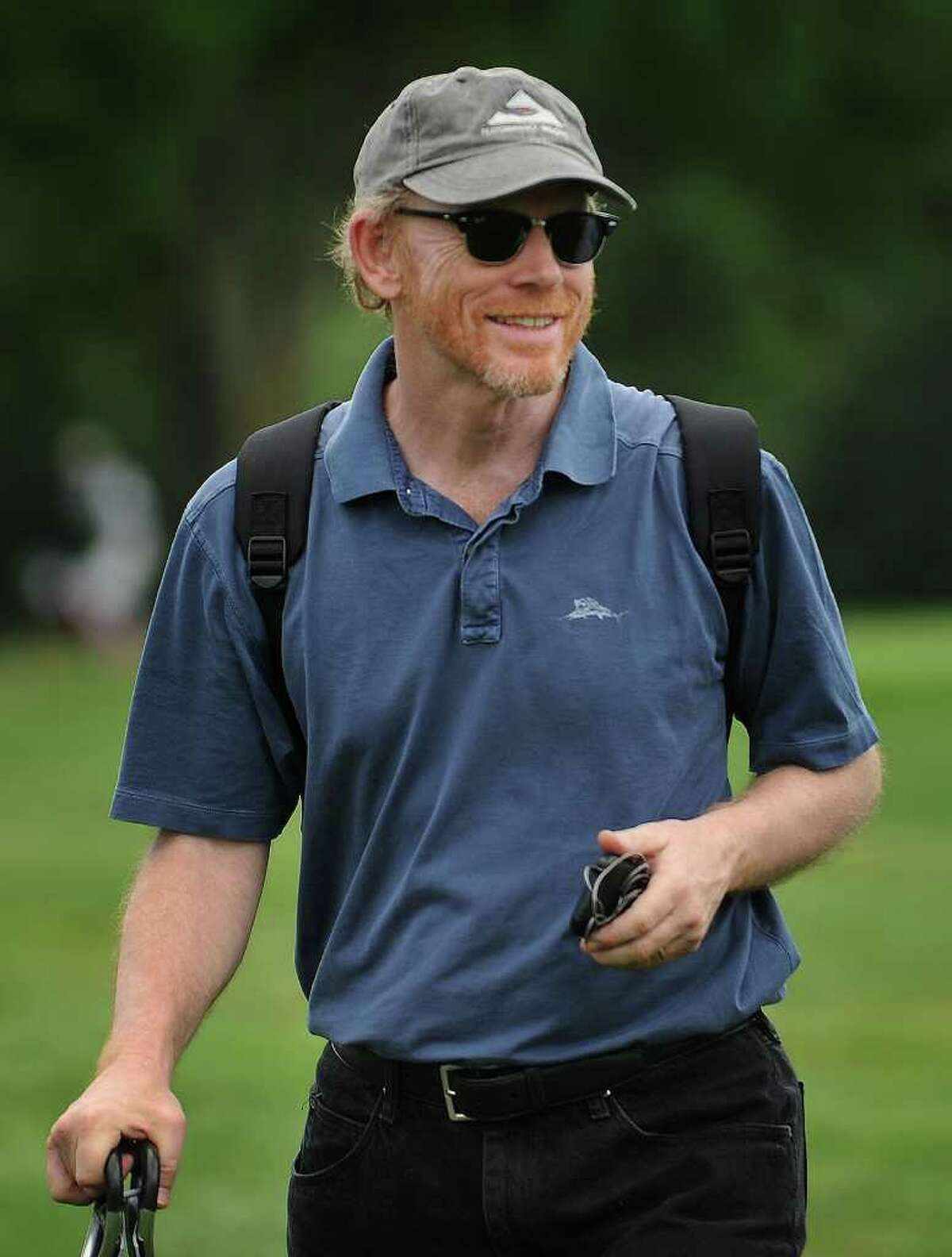Actor/ movie director Ron Howard watches his son Reed Howard of Greenwich play in the Connecticut Open Golf Tournament at Brooklawn Country Club in Fairfield on Wednesday, July 29, 2011.