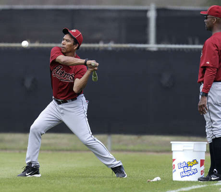 Jose Cruz, a special assistant to general manager Ed Wade, hits fungos for players. Photo: Karen Warren, Chronicle