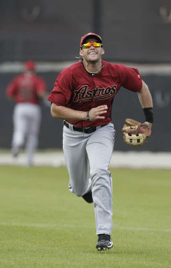 Outfielder J.D. Martinez chases a popup. Photo: Karen Warren, Chronicle