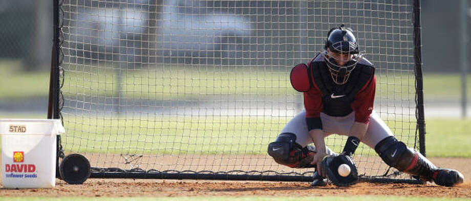 Catcher Jason Castro makes a stop on a ball during drills. Photo: Karen Warren, Chronicle