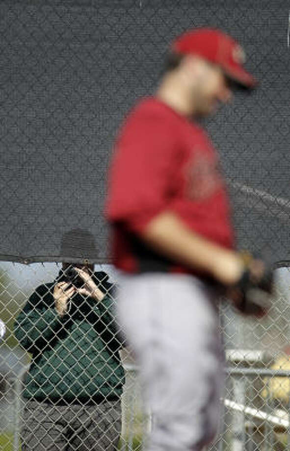 Fans take photos of lefthander Ryan Rowland-Smith as he pitches. Photo: Karen Warren, Chronicle