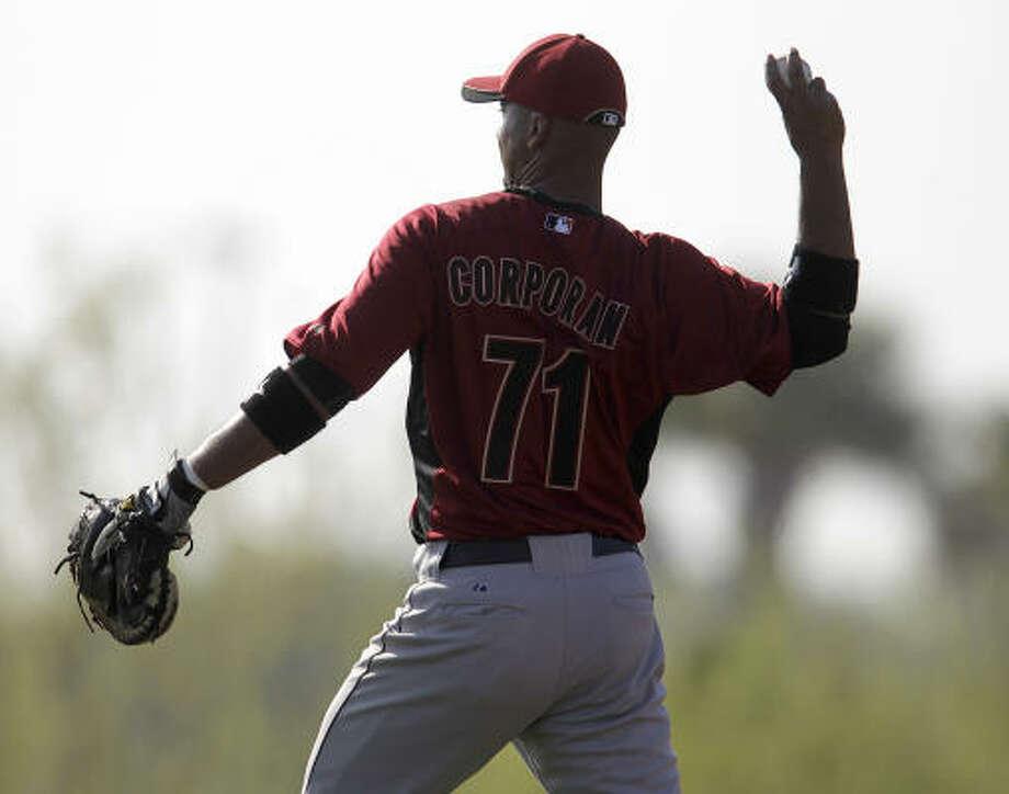 Catcher Carlos Corporan throws the ball during warmups. Photo: Karen Warren, Chronicle