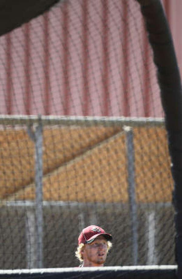 Catcher J.R. Towles watches other catchers during batting practice. Photo: Karen Warren, Chronicle