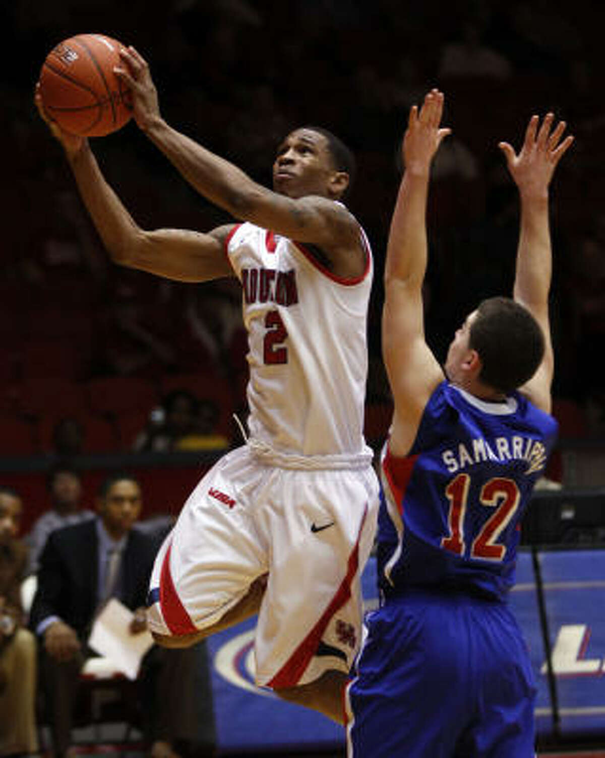 UH guard Zamal Nixon, left, drives to the basket past SMU's Jeremiah Samarrippas during the first half.