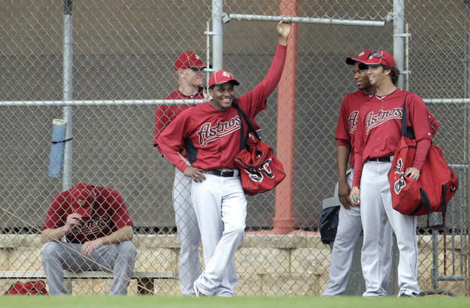 A group of pitchers waits its turn to get onto a field. Photo: Karen Warren, Chronicle