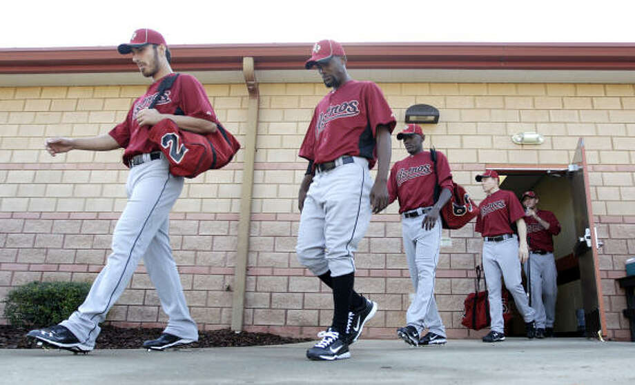 Pitchers walk out of the clubhouse to begin their first workout. Photo: Karen Warren, Chronicle
