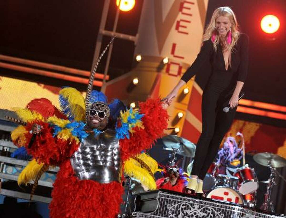 Singers Cee Lo Green and Gwyneth Paltrow perform onstage during The 53rd Annual GRAMMY Awards.