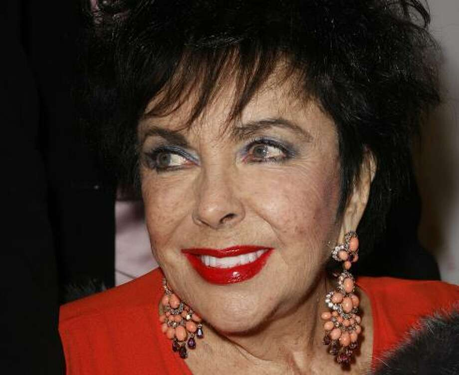 "(FILES) Elizabeth Taylor arrives on the red carpet for her performance of A.R. Gurney's play ""Love Letters"" starring Taylor and James Earl Jones, 01 December 2007 at Paramount Studios in Los Angeles, California. Taylor was recovering in a Los Angeles hospital after being admitted for symptoms of congestive heart failure, her spokeswoman said February 11, 2011. The 78-year-old actress ""was hospitalized earlier this week when she was taken to Cedars Sinai (medical center) suffering from symptoms caused by congestive heart failure, an ongoing condition,"" said publicist Sally Morrison.   AFP PHOTO/Robyn BECK/FILES Photo: ROBYN BECK, AFP/Getty Images"