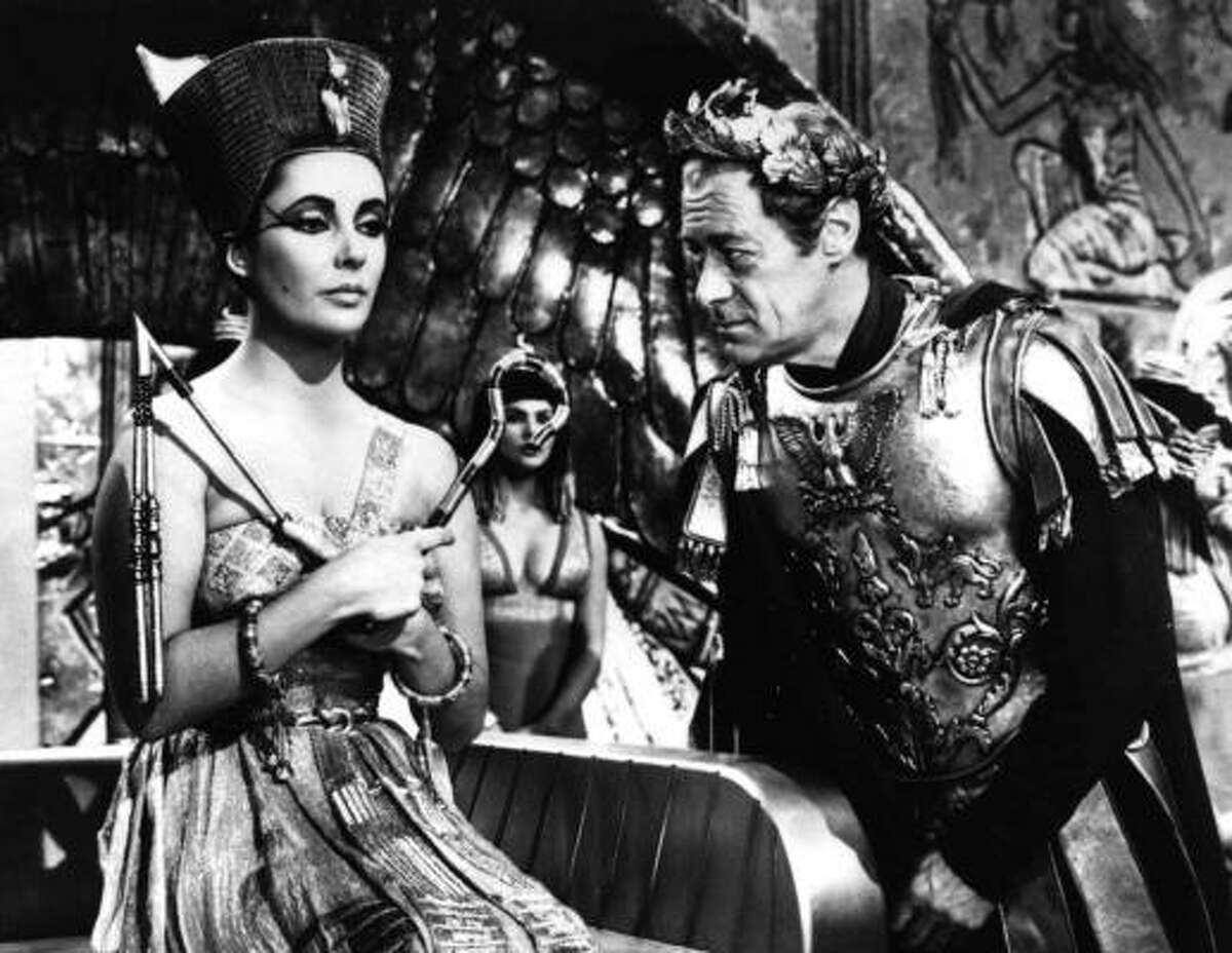 ** ADVANCE FOR WEEKEND EDITIONS JUNE 14-16 ** FILE **-- CLEOPATRA -- Elizabeth Taylor and Rex Harrison appear in a scene from the 1963 film