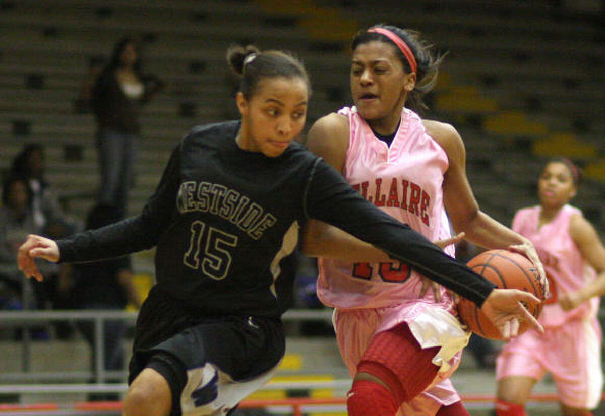 Westside guard Tiffany Davis, front, tries to stop Bellaire's Bianca Winslow from driving to the basket in the third quarter.