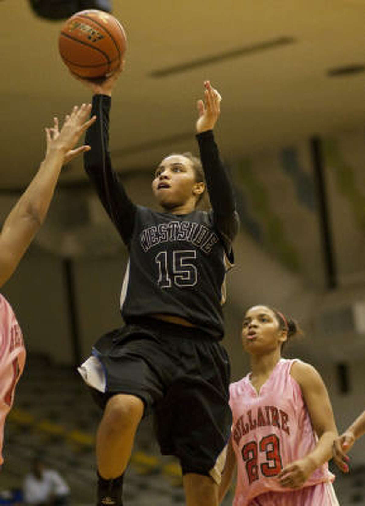 Westside's Tiffany Davis drives to the basket in front of Bellaire's A.J. Alix (23) in the fourth quarter.