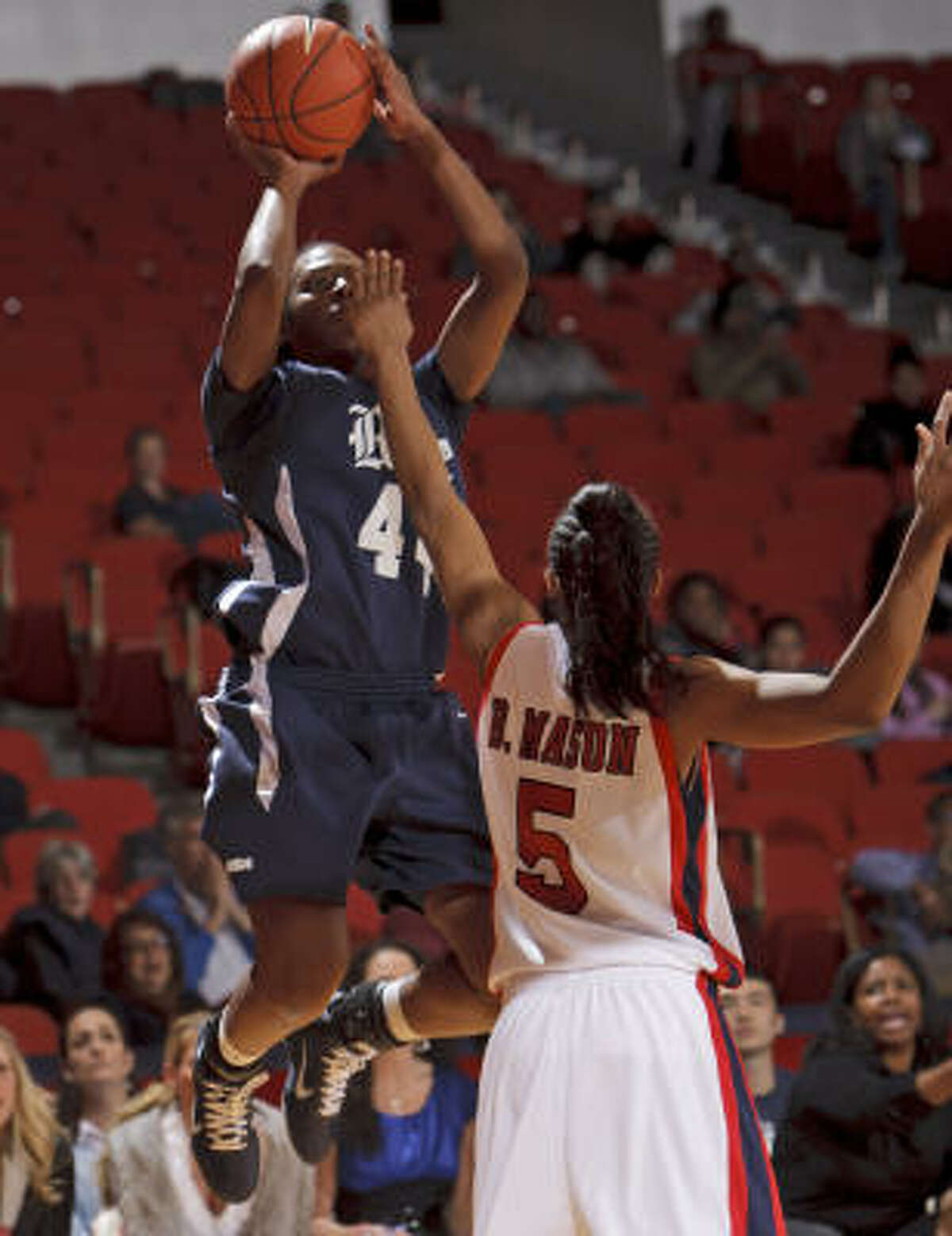 Rice's Morgan Mayse shoots over UH's Brittany Mason. Mayse finished with 16 points and six rebounds.