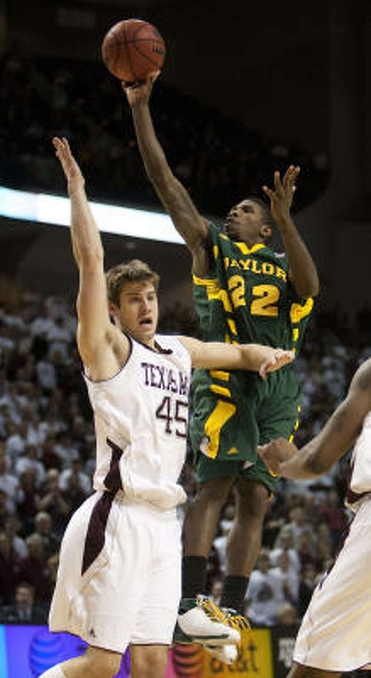 Baylor guard A.J. Walton (22) shoots the ball over Texas A&M's Nathan Walkup (45) during the second half.