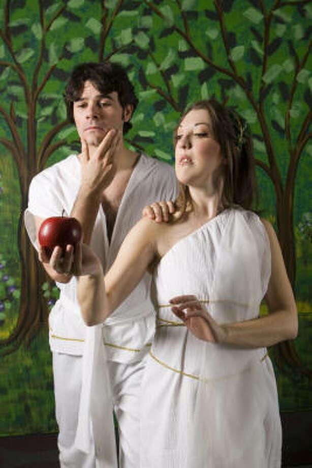 Adam (Brad Scarborough) and Eve (Kristina Sullivan) pose for a scene in Masquerade Theatre's musical production of Children of Eden. Photo: Brett Coomer, Chronicle