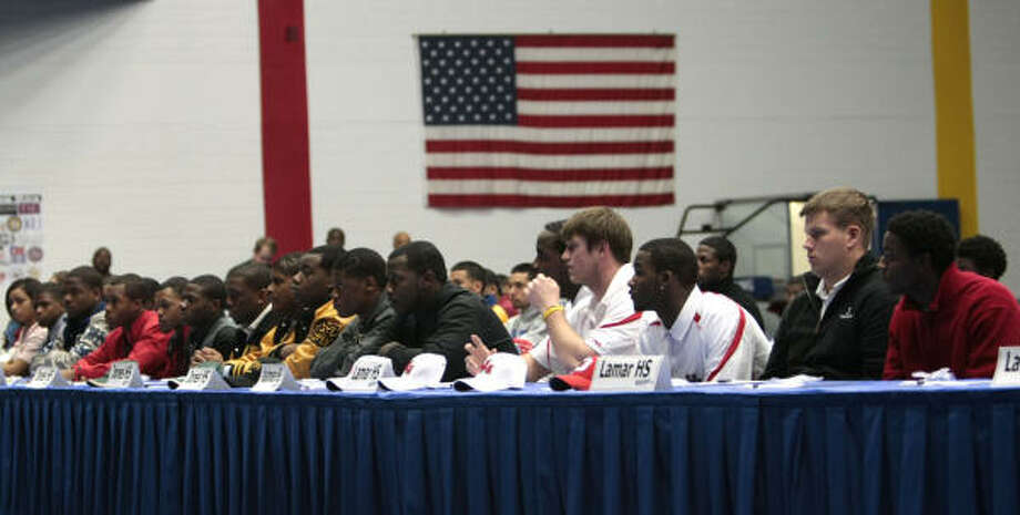 More than 100 HISD athletes gathered at Delmar Fieldhouse on Wednesday for a National Signing Day ceremony. Photo: Billy Smith II, Chronicle