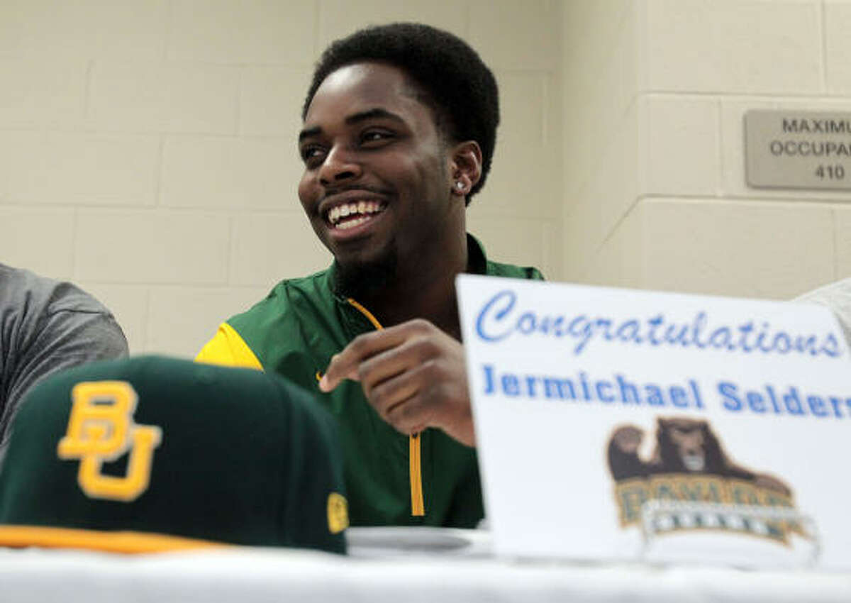 Cy Creek running back Jermichael Selders prepares to sign his letter of intent to play football at Baylor.