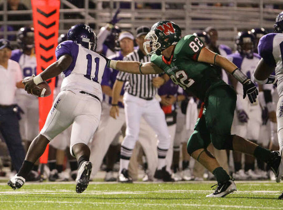 Michael Cooper (right), DL, The Woodlands Height: 6-5 Weight: 230 Destination: Arizona Photo: Nick De La Torre, Chronicle