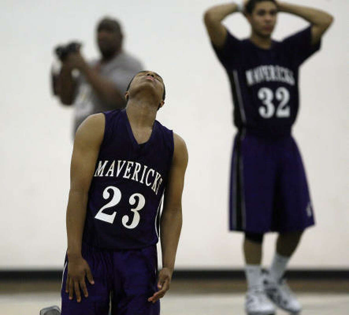 Morton Ranch's Michael Harmon (23) and Bill Herbert (32) are dejected after losing in double overtime.