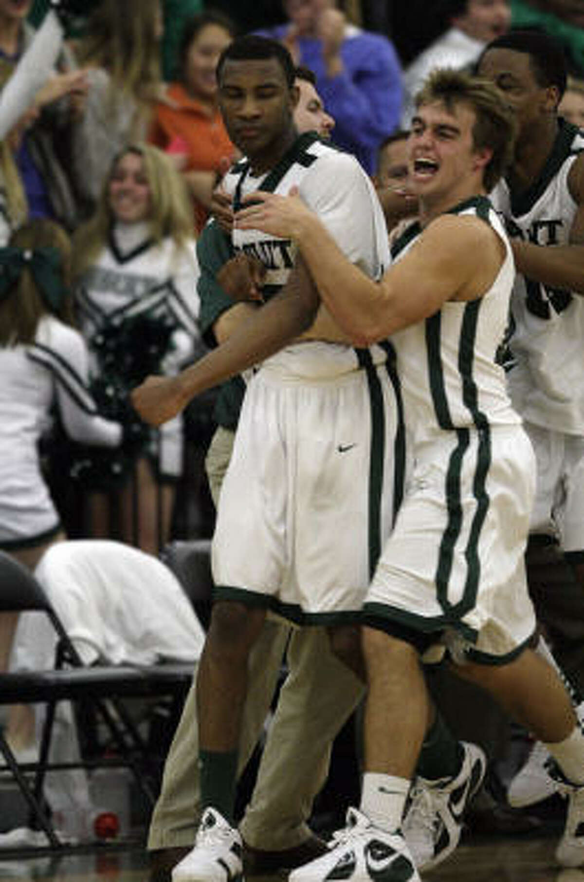 Strake Jesuit's Rasheed Sulaimon, left, is hugged by Will Huskinson after he hit the winning shot.