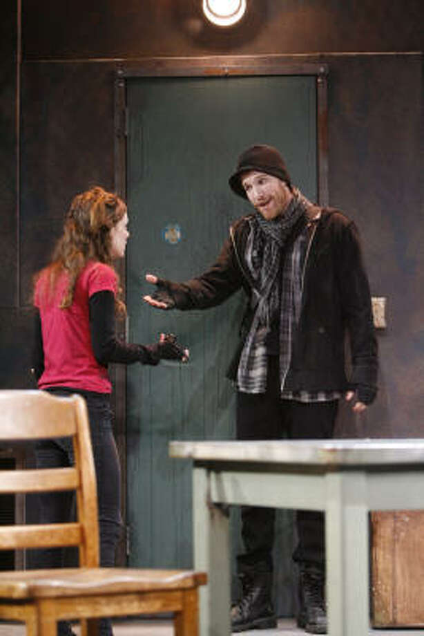 Milena (Stephanie Wright Thompson) and Damon (Matt Dickson) hide out when a revolution erupts in the Stages production of Wallflower. Photo: Julio Cortez, Chronicle