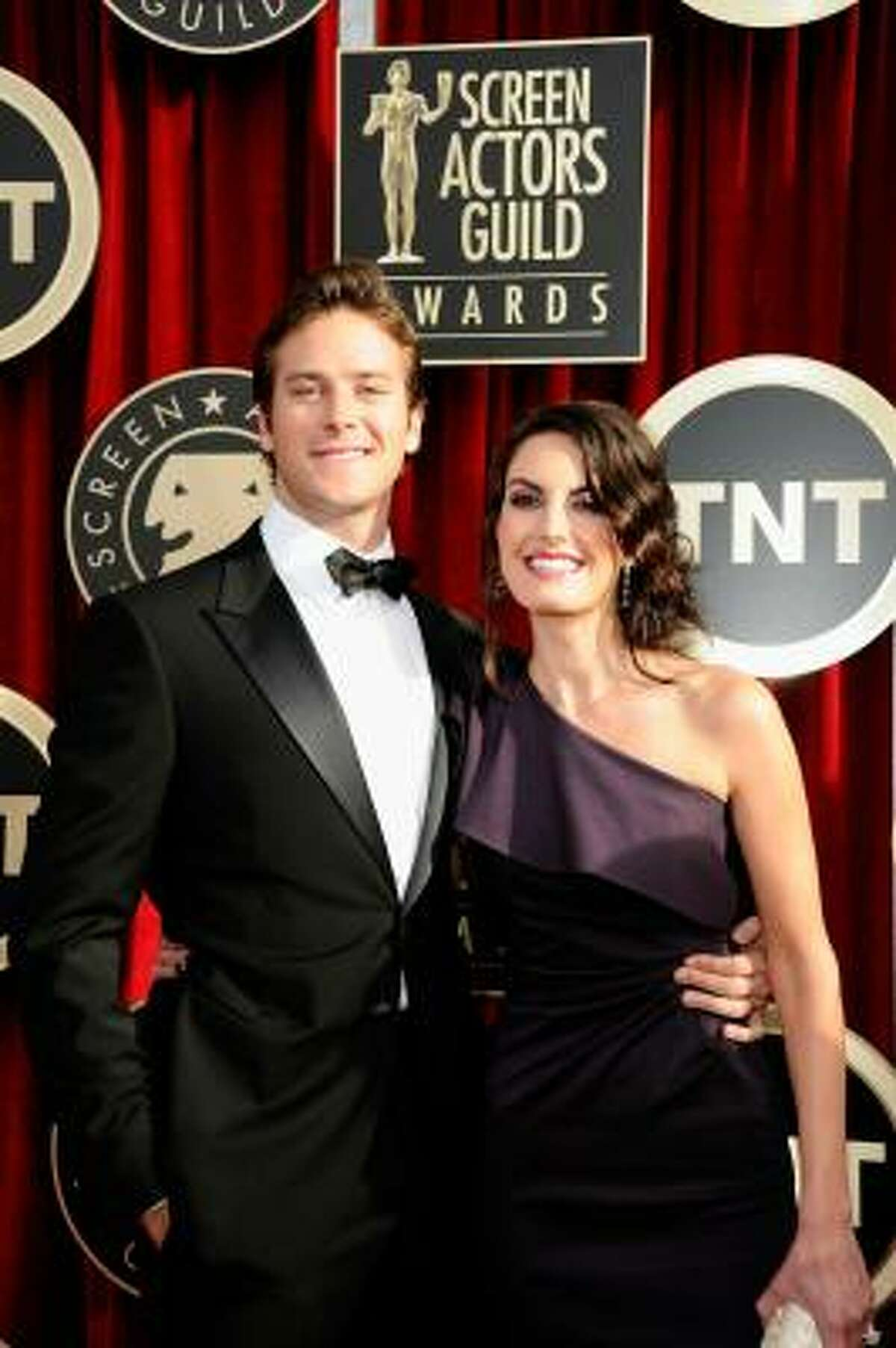 Actor Armie Hammer, left, and actress Elizabeth Chambers