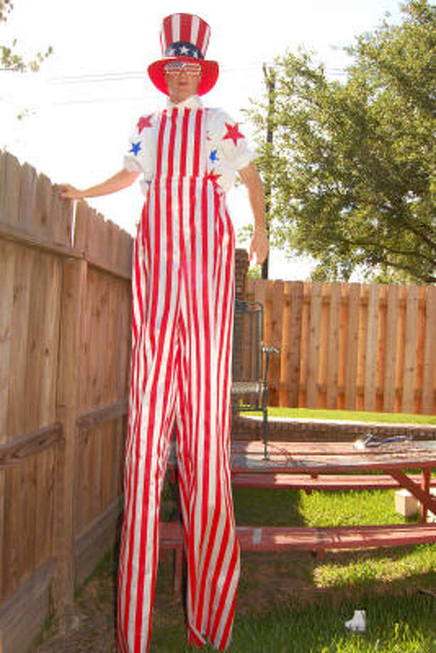 EXTRA LARGE: Daniel Rockey wears the Uncle Sam costume he made to wear in the Friendswood Fourth of July parade. Photo: Wendy Rudnicki, For The Chronicle