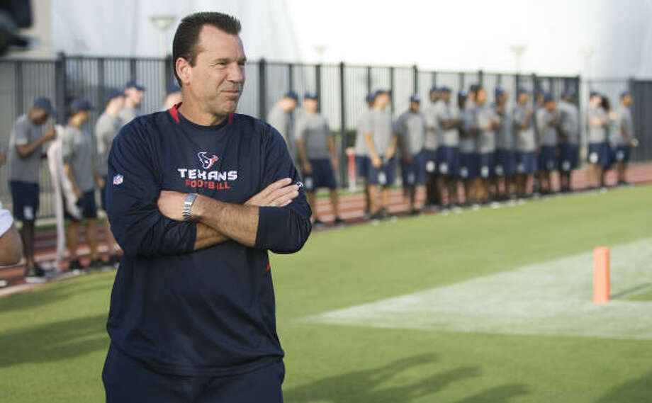 Gary Kubiak's calming influence should be an important factor in helping the Texans get assimilated to three new defensive coaches, including defensive coordinator Frank Bush. Photo: Brett Coomer, Chronicle