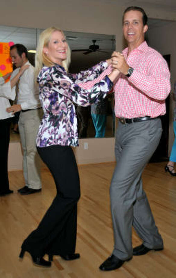 LEADING BY EXAMPLE: Hunter and Maria Johnson offer lessons in more than 20 different dance styles including fox trot, country and western, ramba, waltz and quick step. Photo: Janice Smith, For The Chronicle