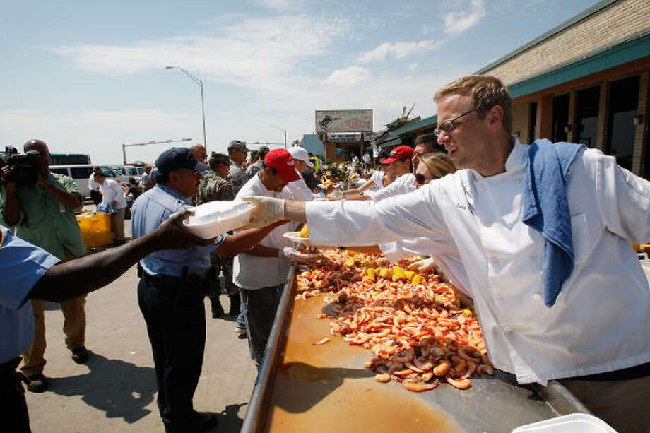 Workers at Gaido's restaurant serve a shrimp lunch to first responders helping with the recovery efforts after Hurricane Ike. Over the course of the storm, responders from across Texas and elsewhere came to the aid of thousands of people. Photo: Scott Olson, Getty Images File
