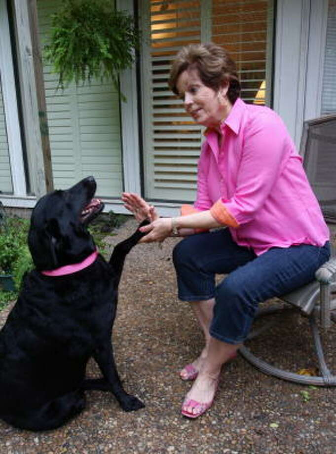 Barbara Montgomery of Sugar Land discovered a lump in her breast three years ago after playing  with her dog, Meg. Photo: Suzanne Rehak, For The Chronicle