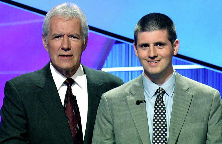 SPECTRUM/Brian McEntee, who grew up in New Milford and graduated from New Milford High School, poses with Jeopardy host Alex Trebek during filming of Mr. McEntee's two-day run on the game show. July 2011  Courtesy of Jeopardy Productions Photo: Contributed Photo