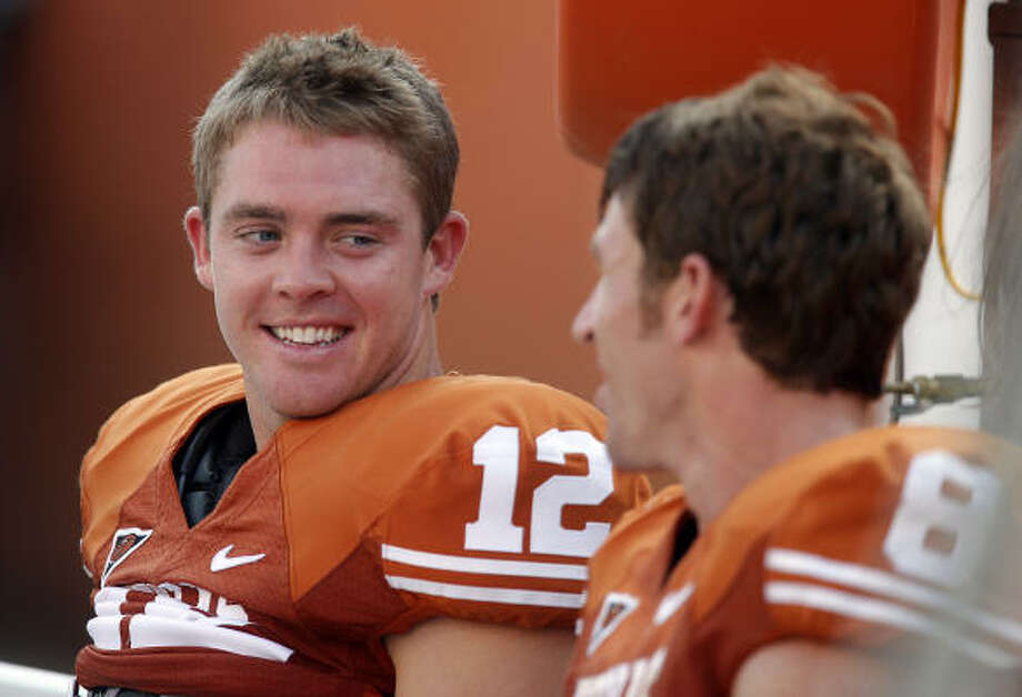 Quarterback Colt McCoy (left) and the Texas Longhorns will face three ranked opponents in October. Photo: Kin Man Hui, San Antonio Express-News
