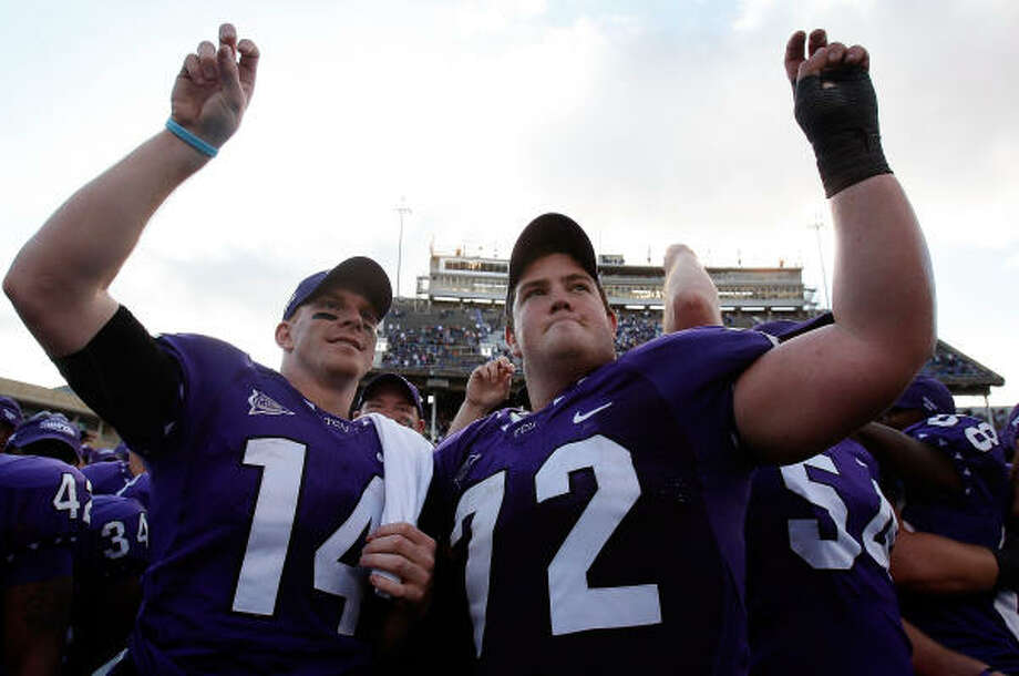 Andy Dalton, left, and Kyle Dooley revel in the completion of TCU's perfect regular season Saturday. Photo: Ronald Martinez, Getty Images