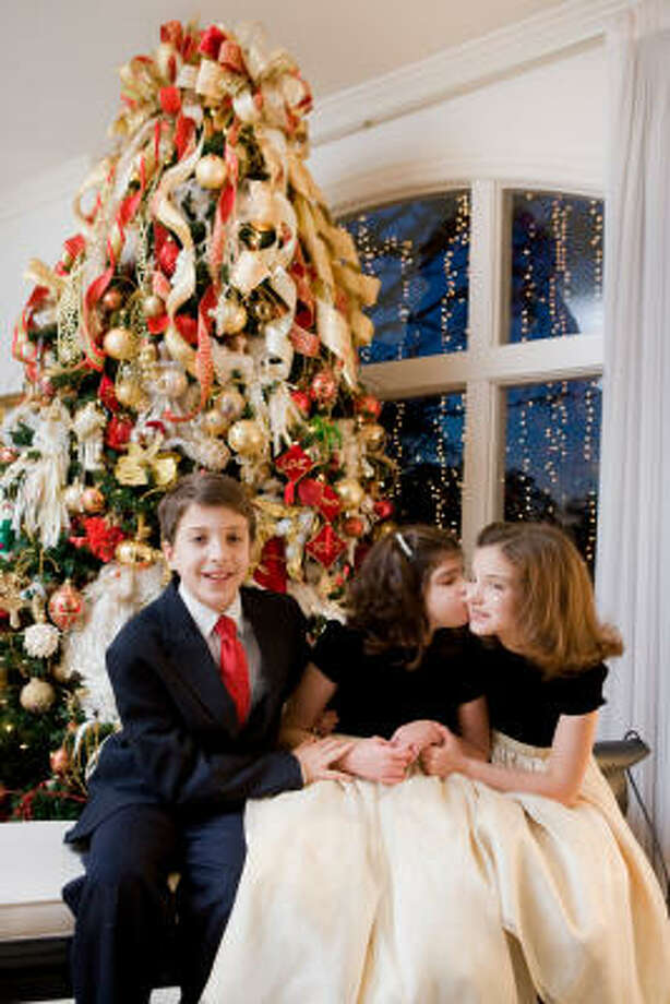 Cynthia Allshouse's mom, Jo Rene Van Voorhis, bought a tree for each triplet — Chance, Chandler and Channing — for their first Christmas. They started hanging ornaments at age 2 1/2. Photo: Jill Hunter, For The Chronicle