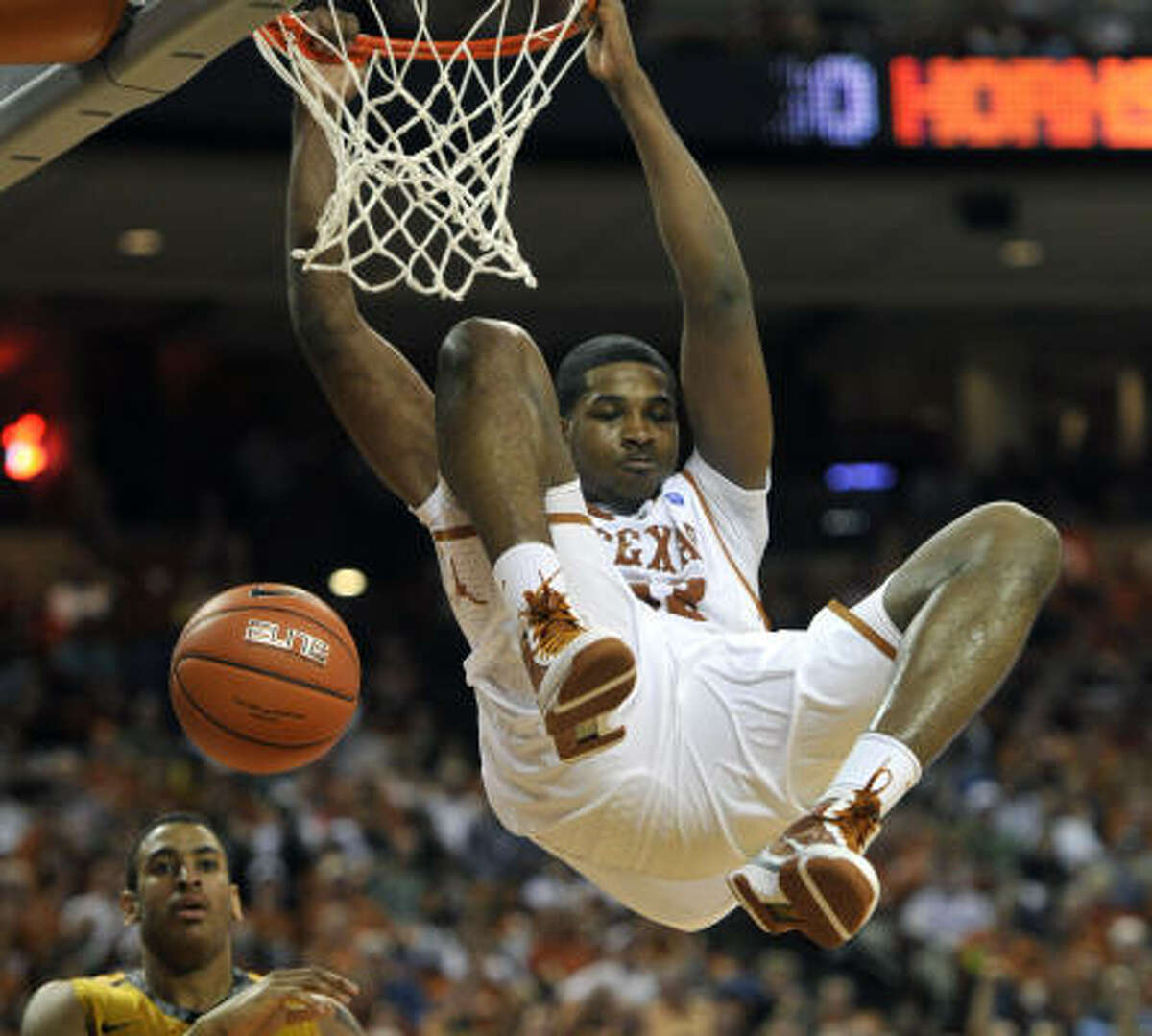Jan. 29: No. 7 Texas 71, No. 11 Missouri 58 Texas forward Tristan Thompson hangs from the rim after dunking against Missouri center Steve Moore during the second half of Saturday's game in Austin.