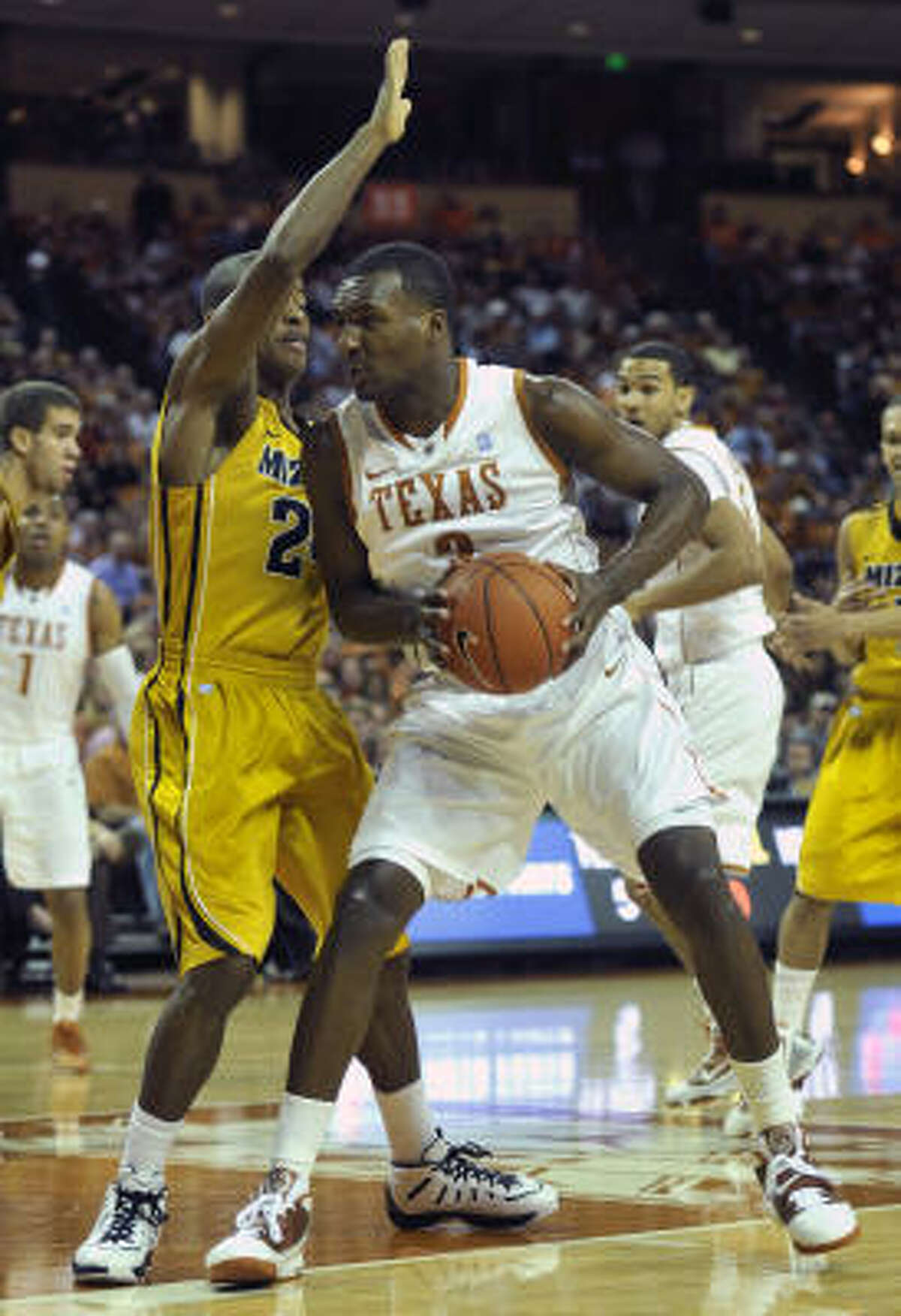 Texas forward Jordan Hamilton, right, drives to the basket against Missouri guard Kim English during the first half. Hamilton had a game-high 16 points and 13 rebounds.
