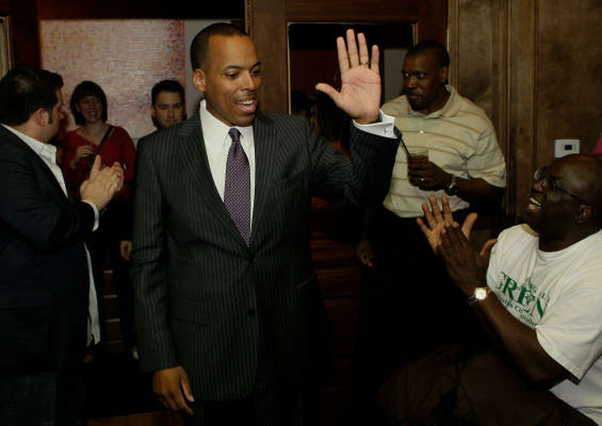 Ronald Green welcomes supporters at an election party near Houston's Sixth Ward.