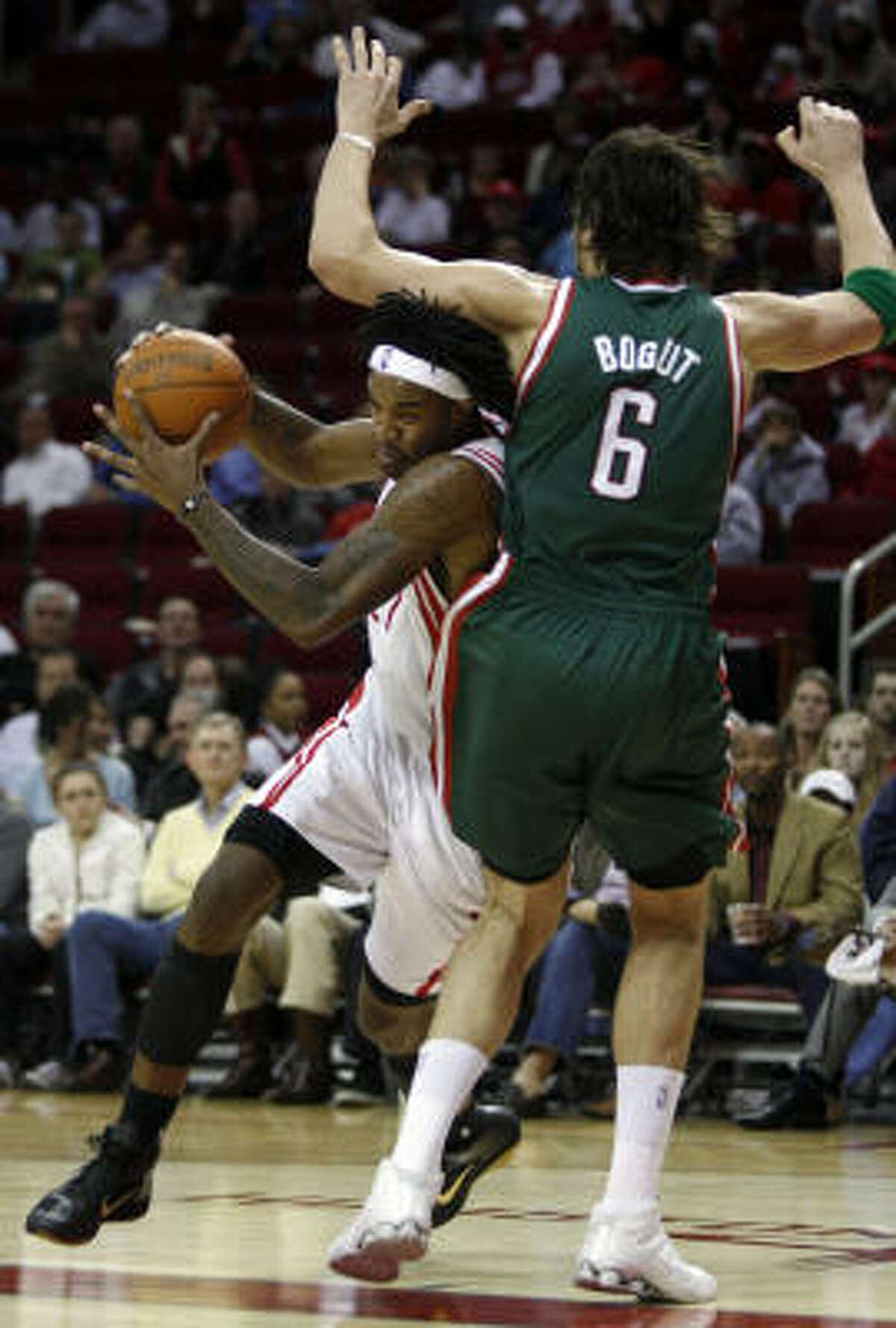 Rockets center Jordan Hill moves around Bucks center Andrew Bogut.