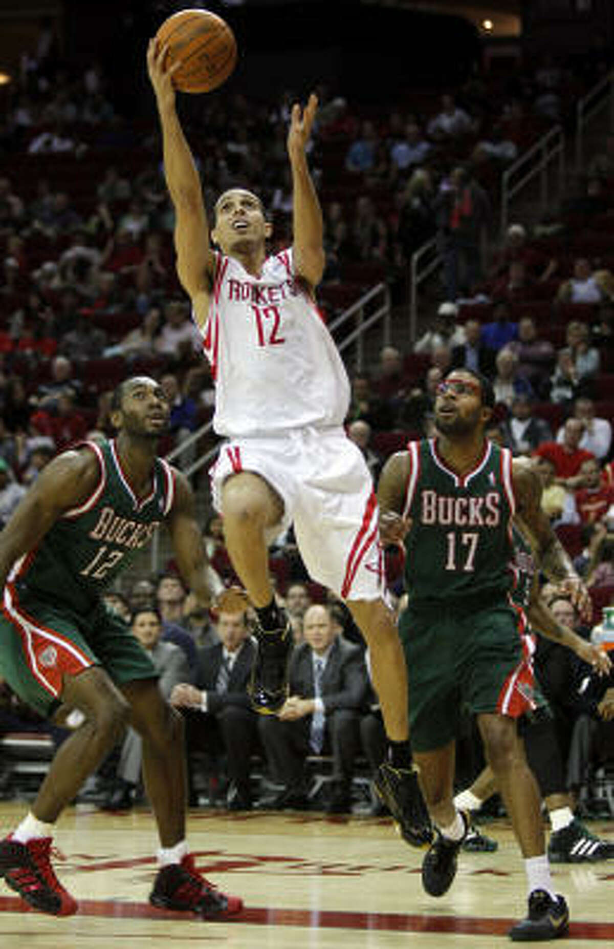 Rockets guard Kevin Martin takes a shot between Bucks forwards Luc Mbah a Moute and Chris Douglas-Roberts.