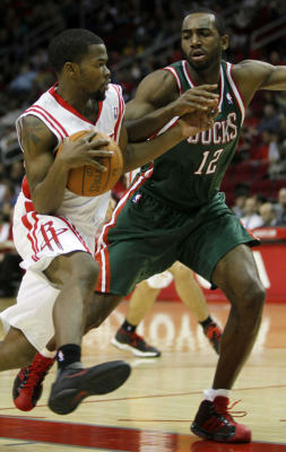 Rockets point guard Aaron Brooks works to get around Bucks forward Luc Mbah a Moute during the fourth quarter.
