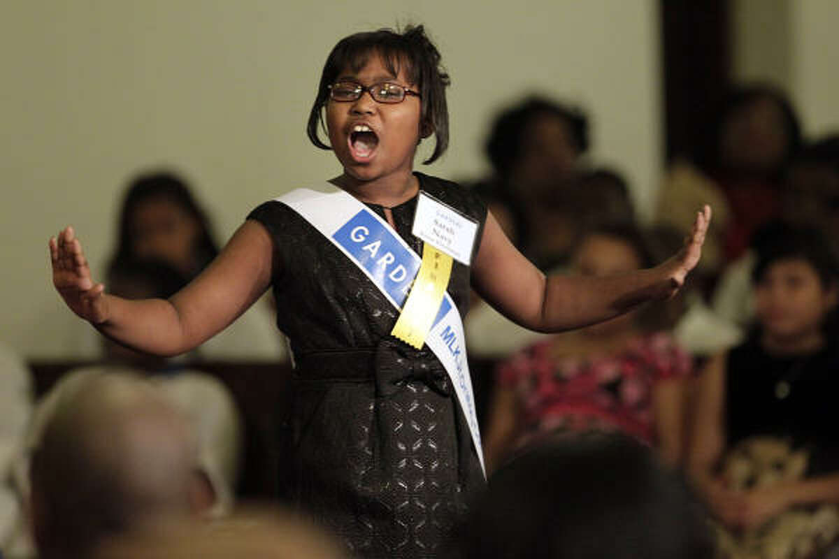 Sarah Navy , 5th grader at Burrus Elementary School, delivers her speech during the 15th Annual Gardere Martin Luther King. Jr. Oratory Competition at the historic Antioch Missionary Baptist Church of Christ in Houston.
